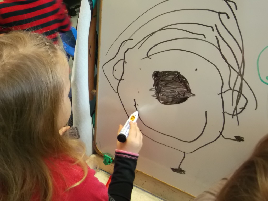 drawing a face on the whiteboard - edited